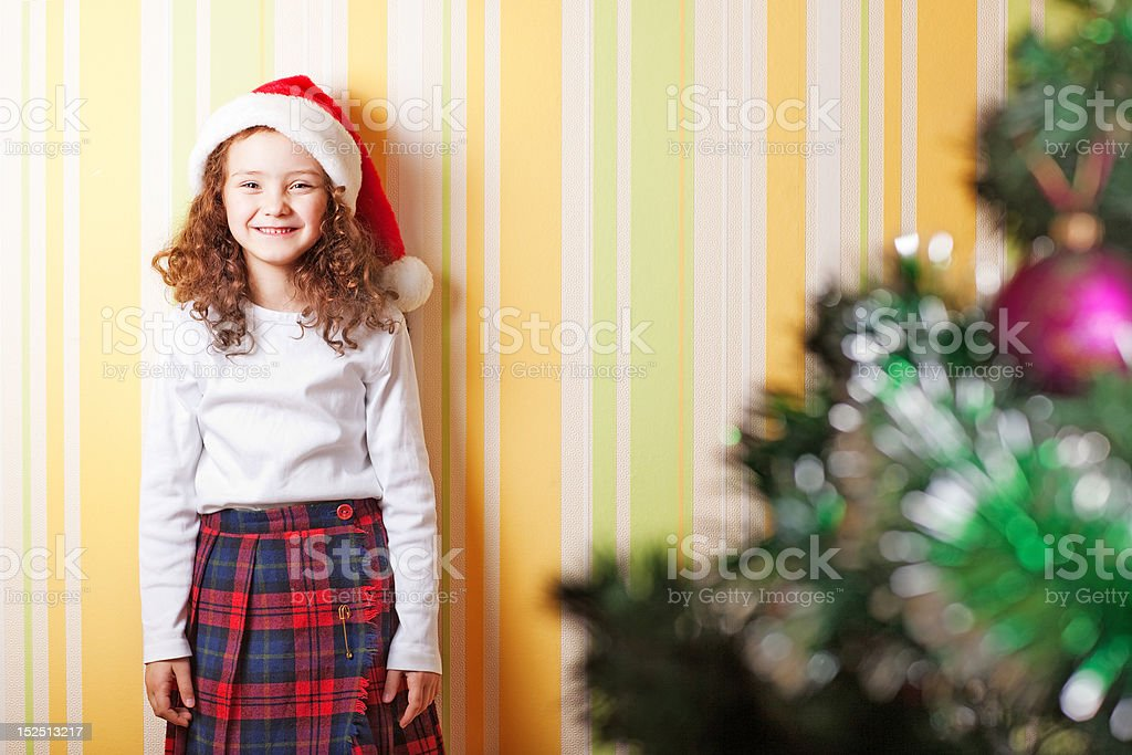little girl near wall stock photo