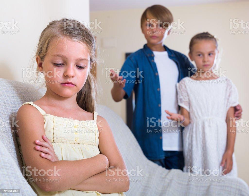 Little girl offended on other children stock photo