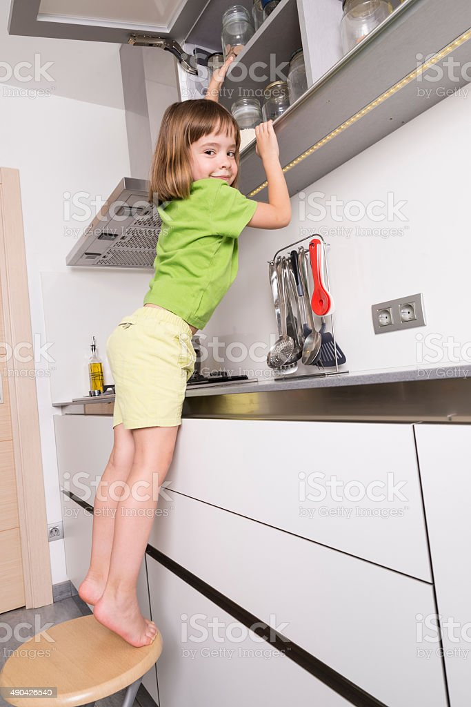 Little girl on a chair stock photo