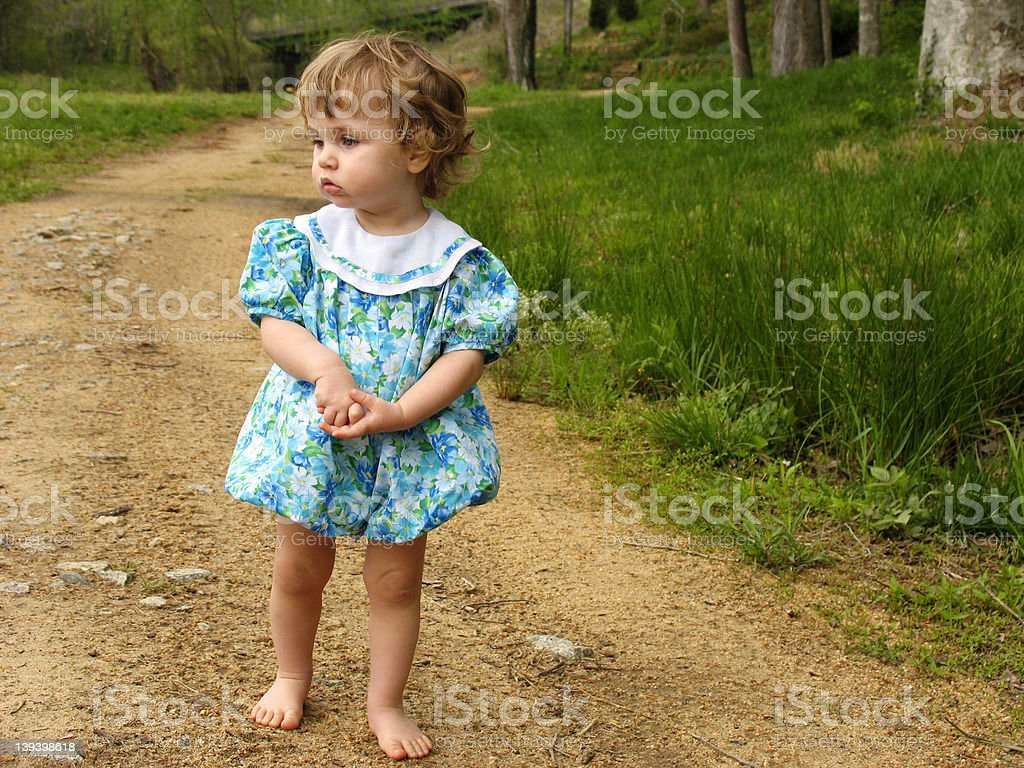 Little girl on a dirt road royalty-free stock photo