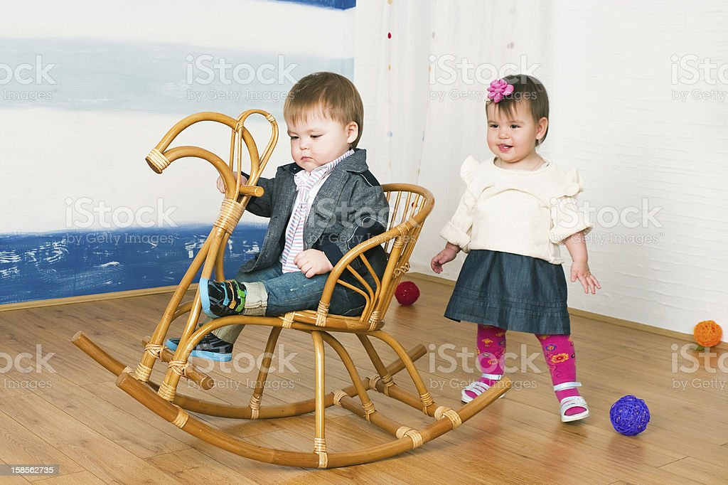 little girl on a horse rocking chair royalty-free stock photo