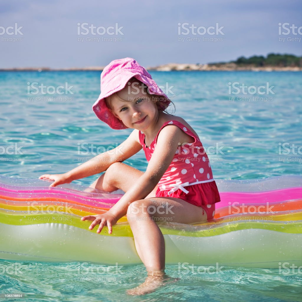 Little girl on a raft royalty-free stock photo