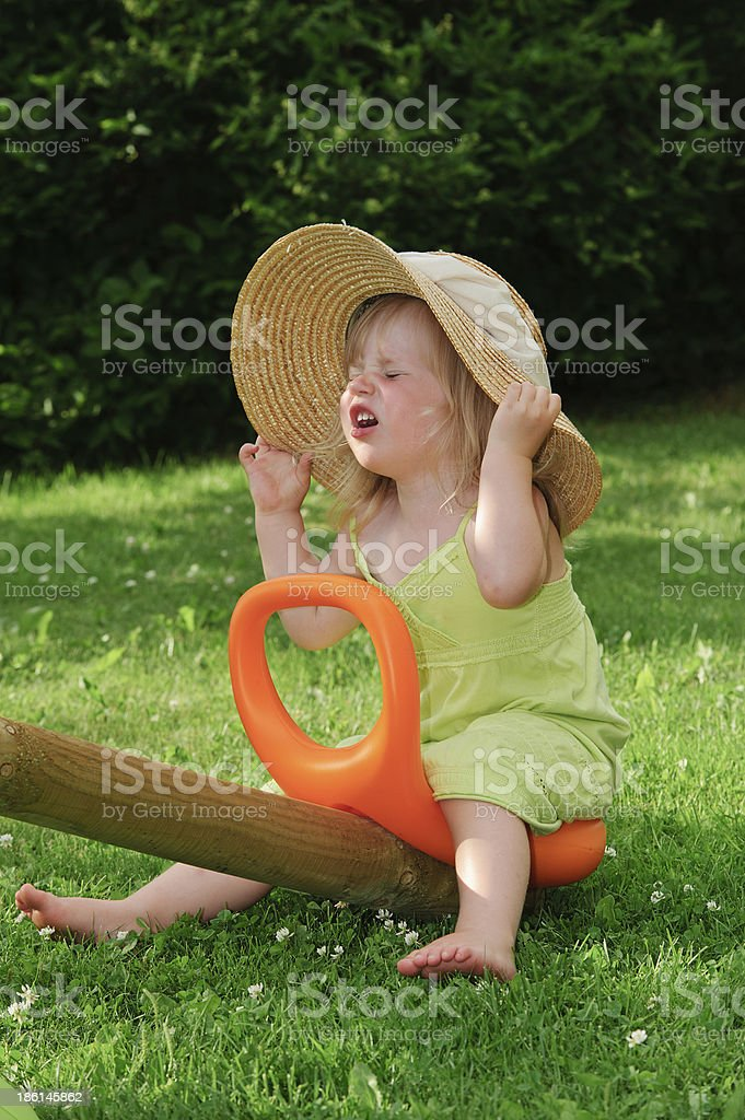 little girl on a see-saw royalty-free stock photo