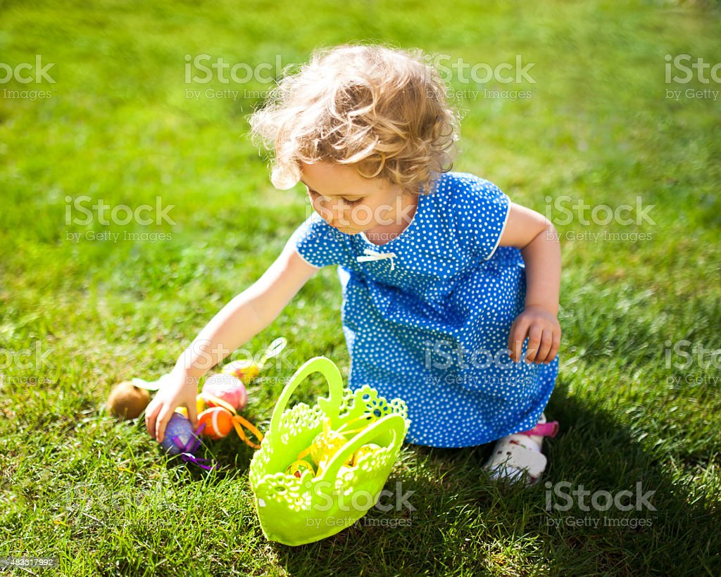 Little Girl on an Easter Egg hunt stock photo