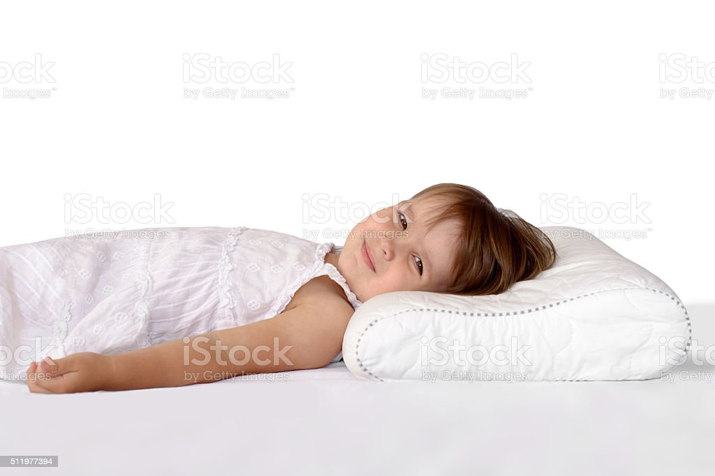 Little girl on an orthopedic pillow stock photo