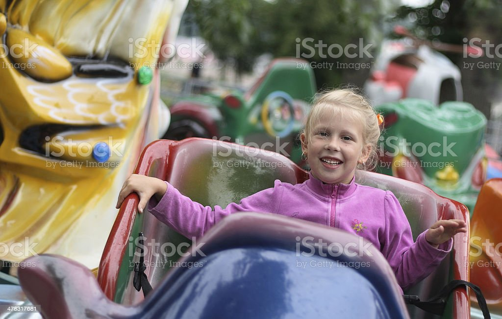 Little girl on carousel royalty-free stock photo