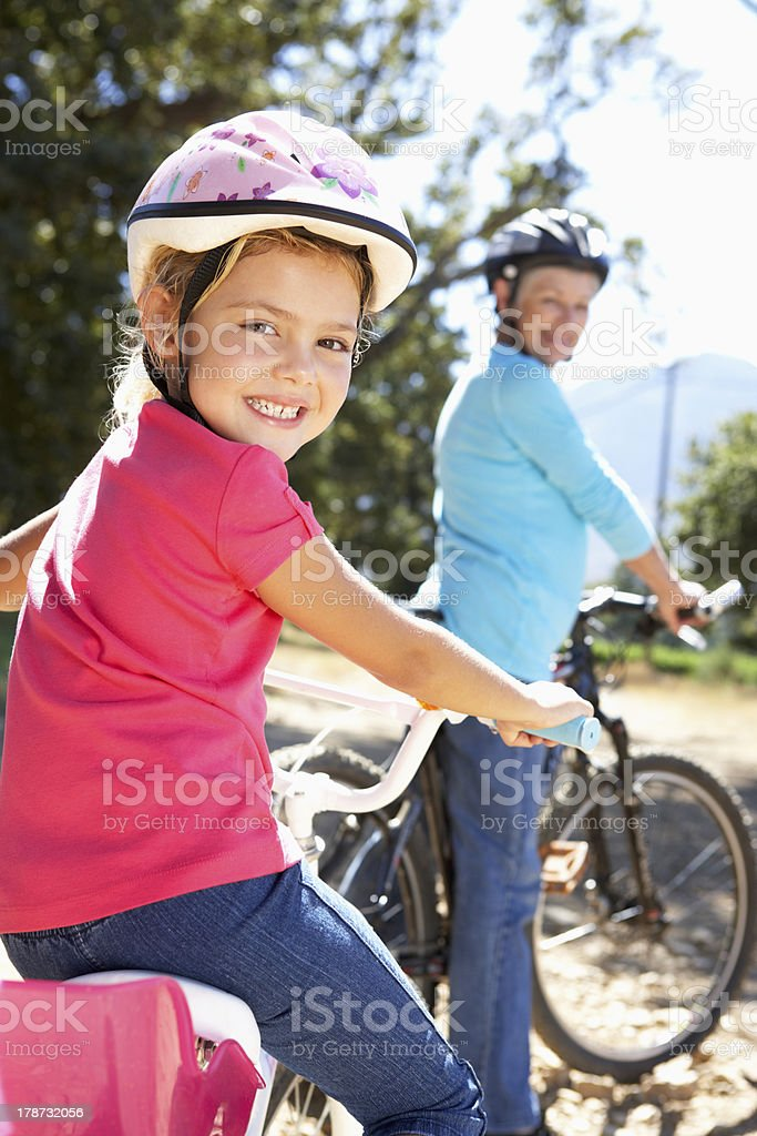Little girl on country bike ride with grandma stock photo