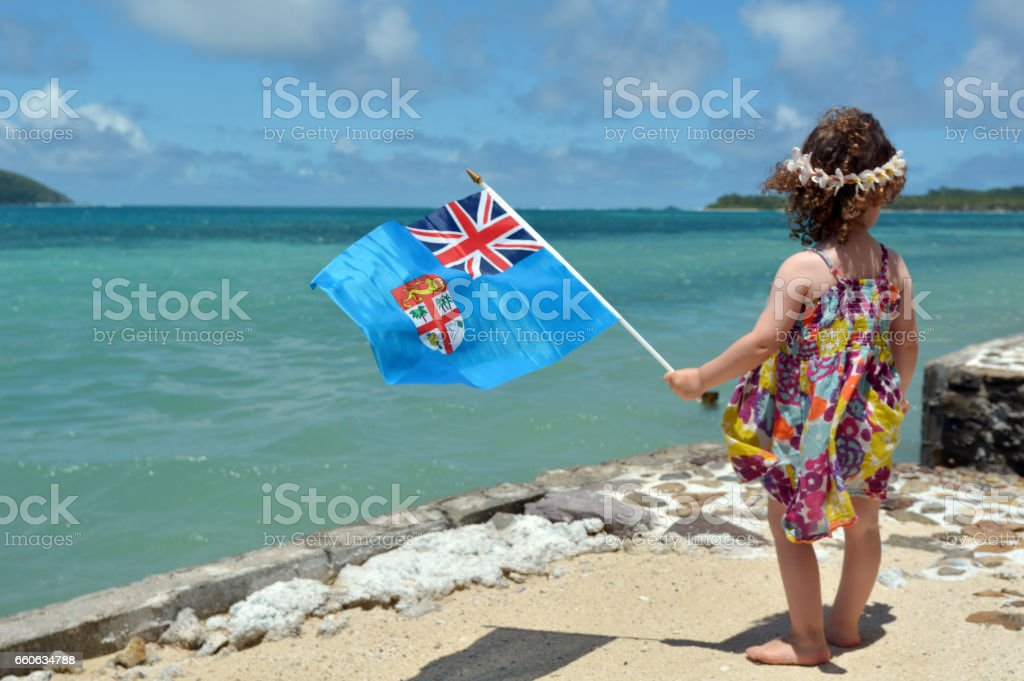 Little girl on family travel holiday vacation in Fiji stock photo