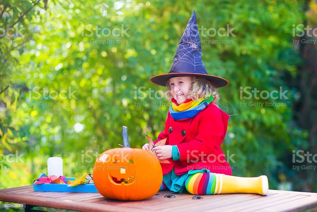 Little girl on Halloween stock photo