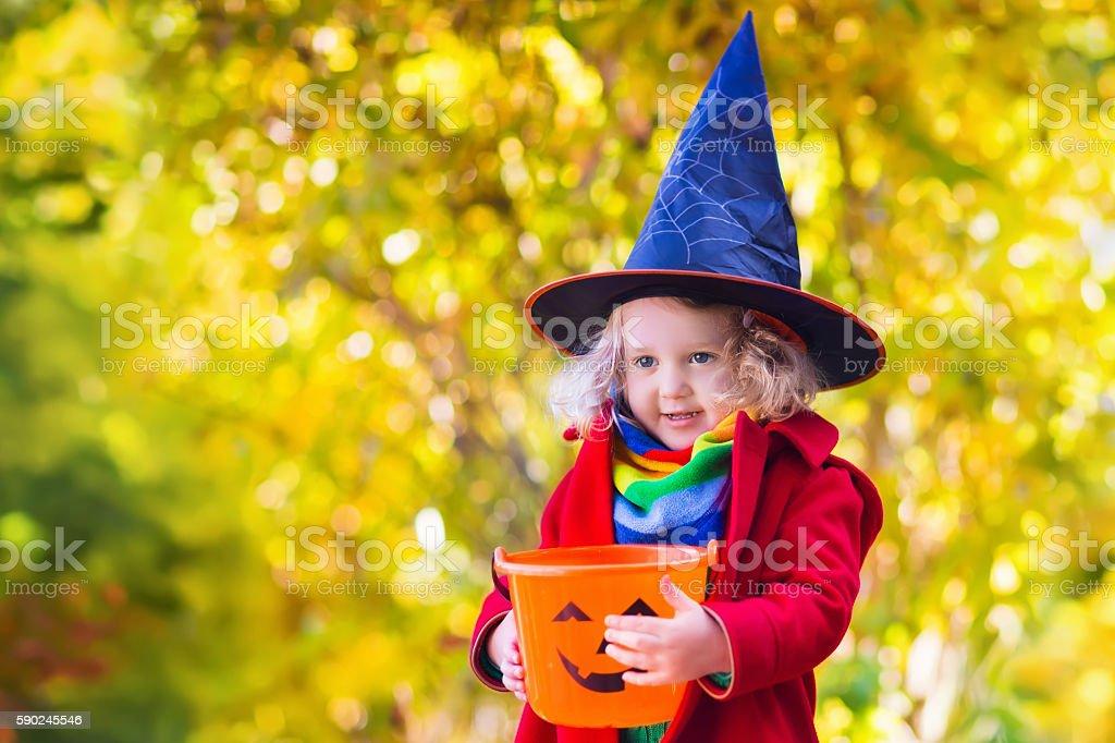 Little girl on Halloween trick or treat stock photo