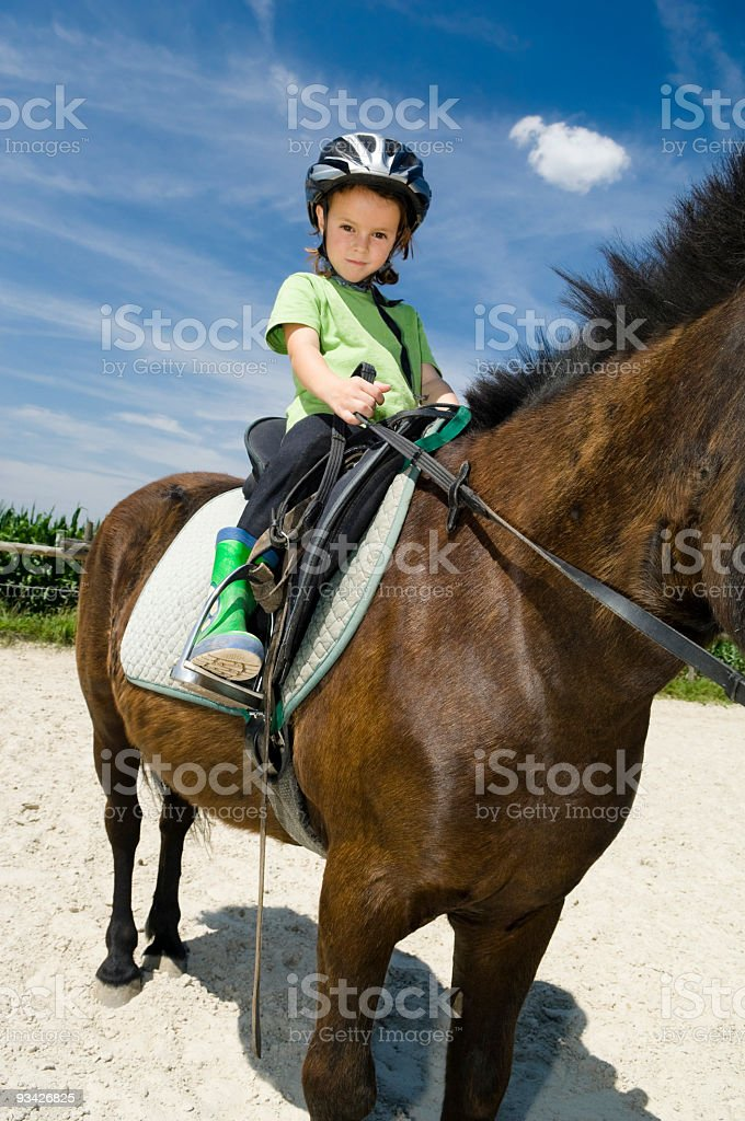 Little Girl on Horseback royalty-free stock photo
