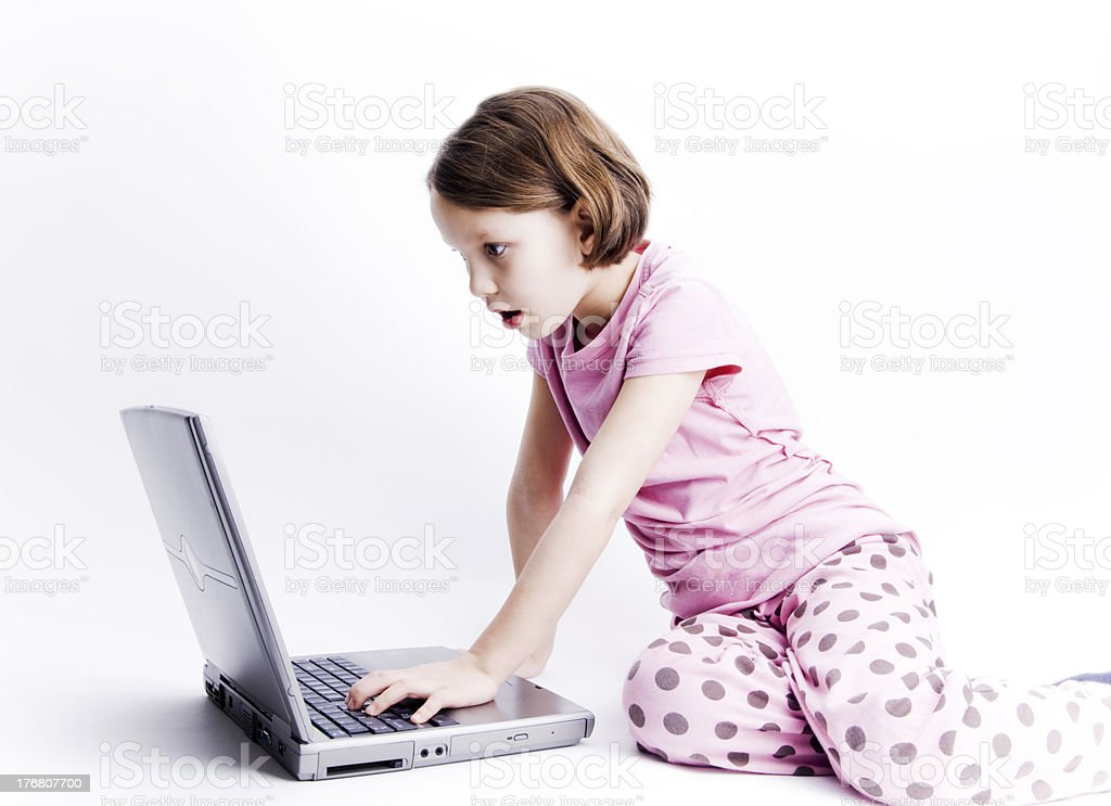 Little Girl On Notebook Surprised, Parental Controls Concept stock photo