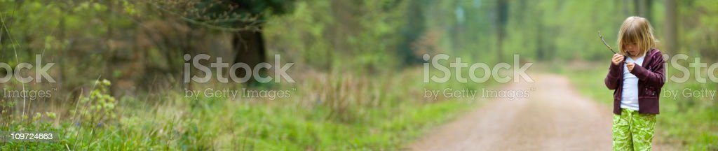 Little Girl on Path in Forest royalty-free stock photo