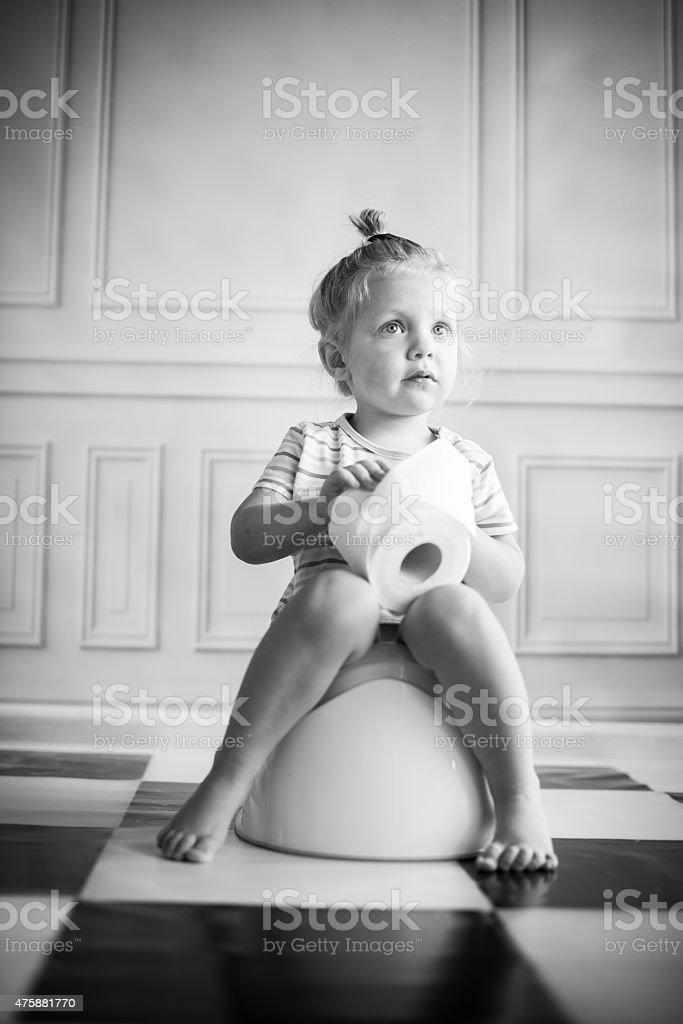 Little girl on potty stock photo
