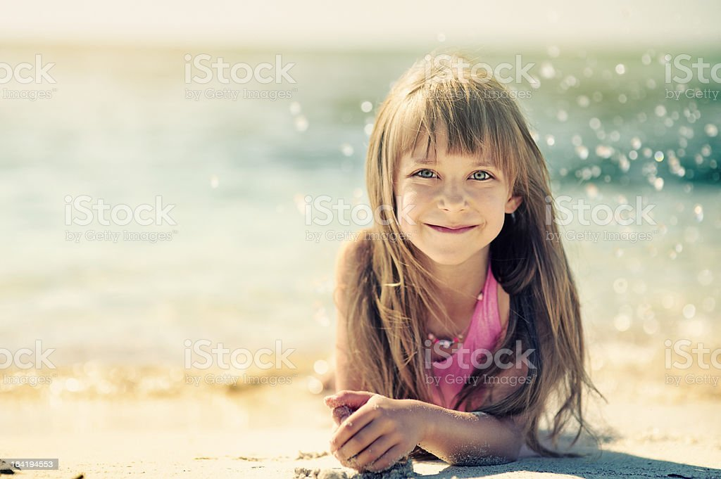 Little girl on the beach. royalty-free stock photo