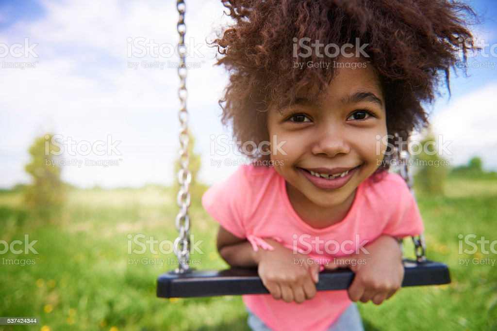 Little girl on the playground stock photo