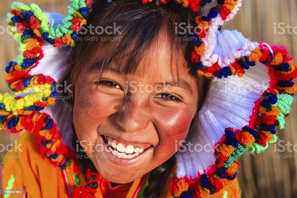 Little girl on Uros floating island, Lake Tititcaca, Peru royalty-free stock photo