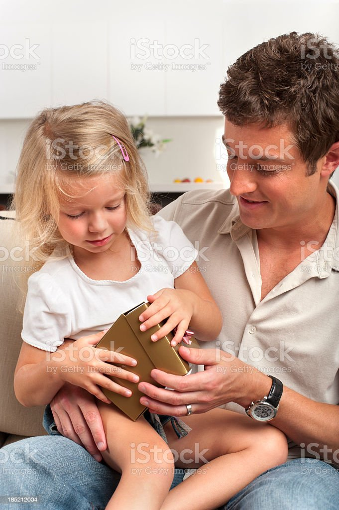 Little girl opening a gift royalty-free stock photo