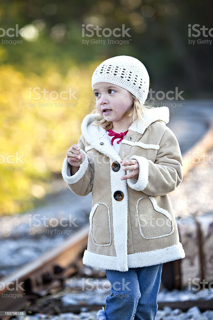 Little girl outdoors in cot and hat royalty-free stock photo