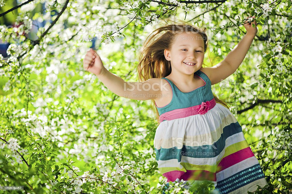 Little girl outdoors in spring time royalty-free stock photo