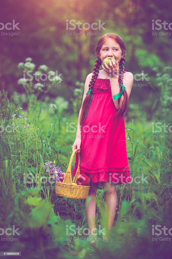 Little girl outdoors in summer stock photo