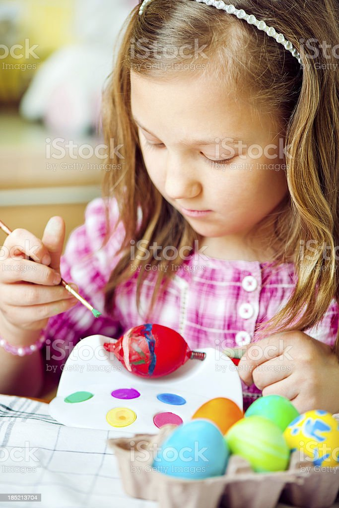 Little girl painting Easter eggs royalty-free stock photo