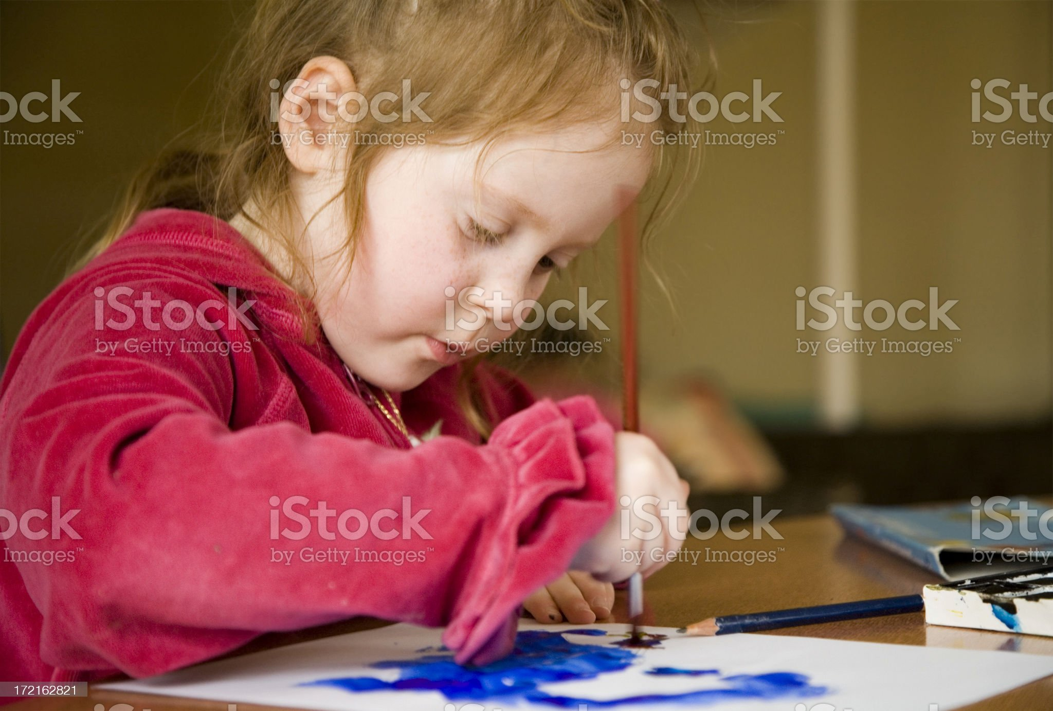 Little girl painting in concentration royalty-free stock photo