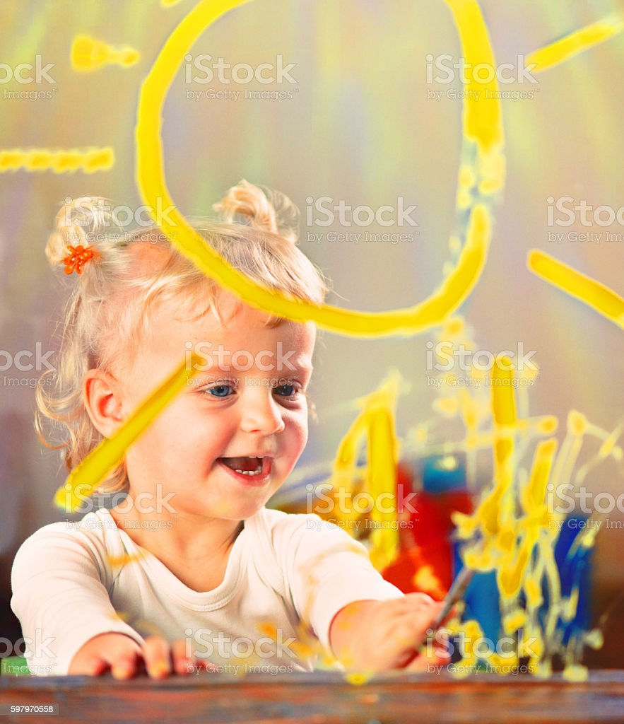 Little Girl Painting on Glass stock photo