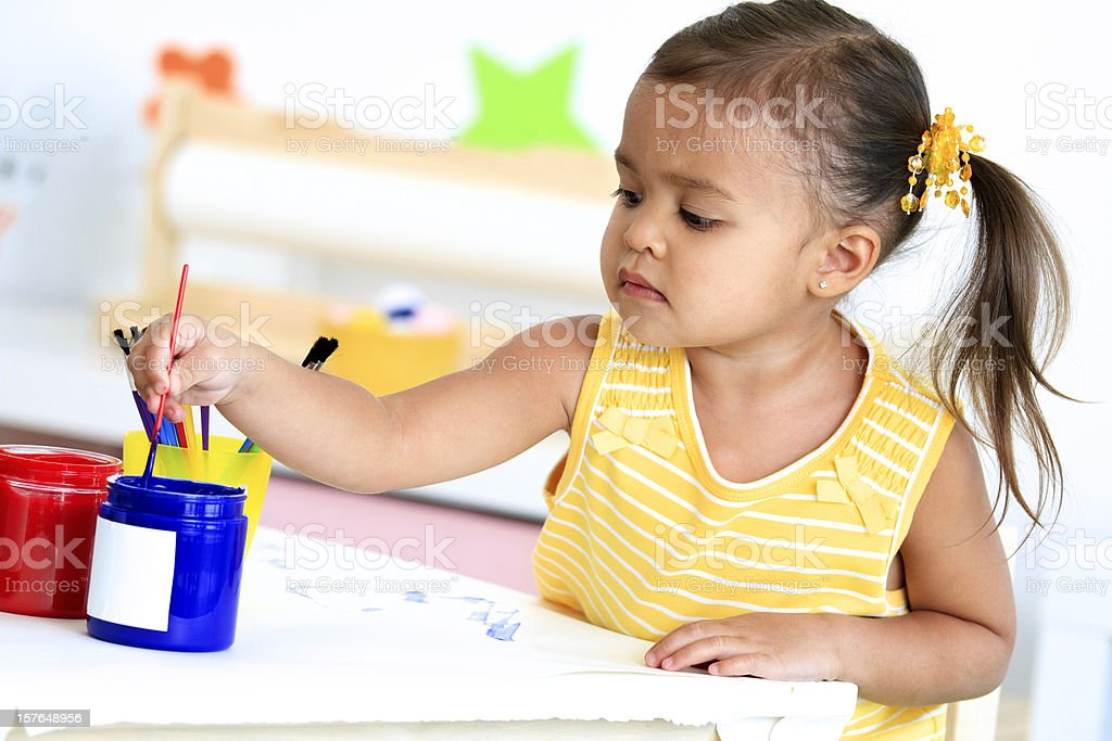 Little Girl Painting stock photo
