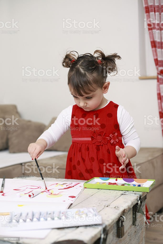 Little girl painting with tempera royalty-free stock photo