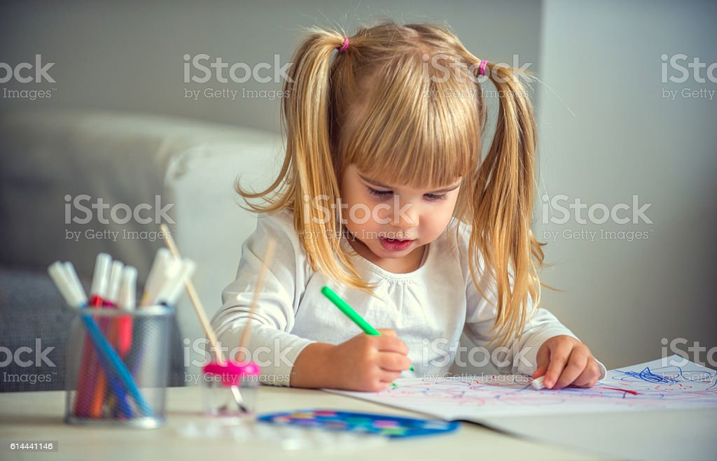 Little girl paiting stock photo