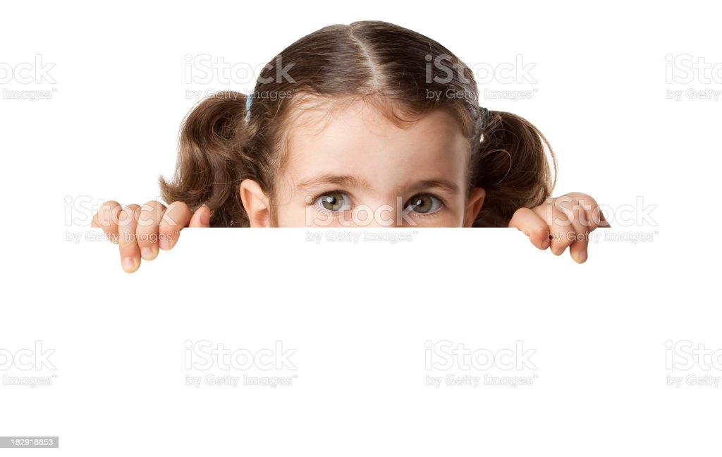 Little girl peeking from blank sign royalty-free stock photo