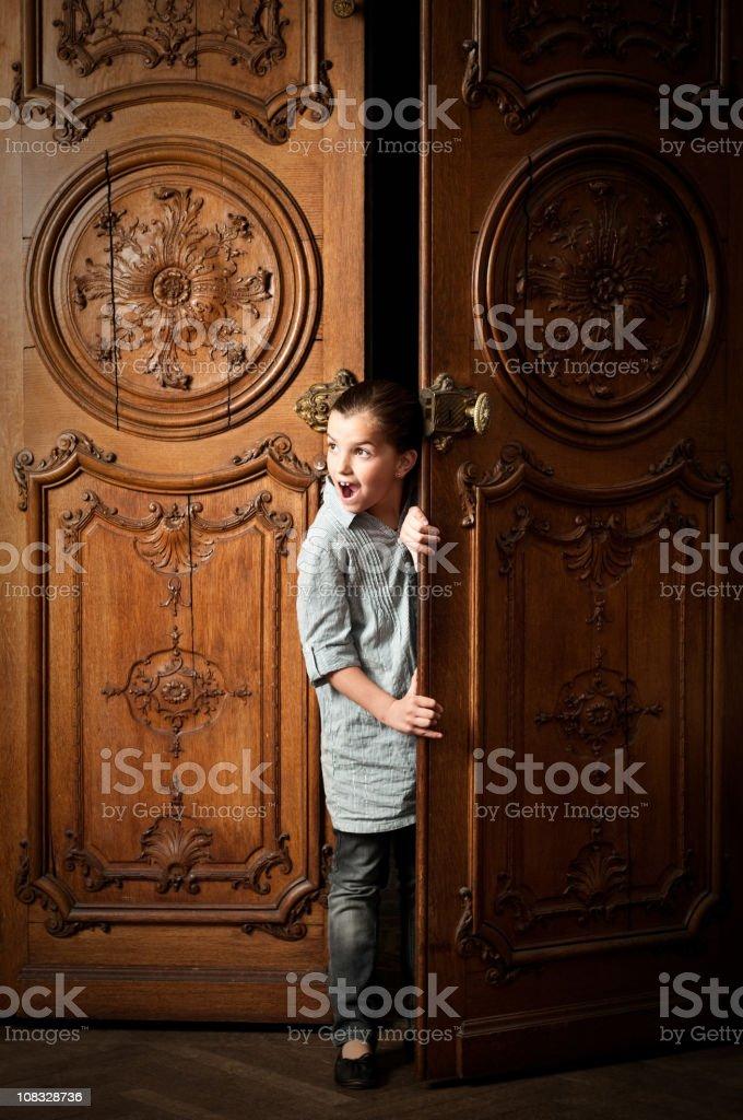 Little girl peeping royalty-free stock photo