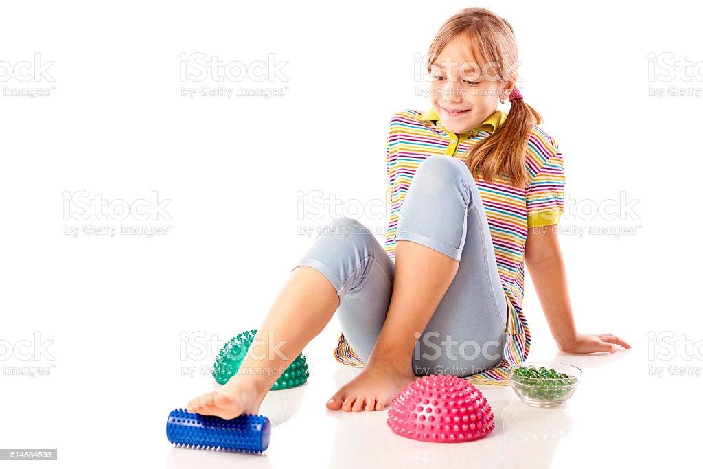 Little girl performing flat feet exercises stock photo