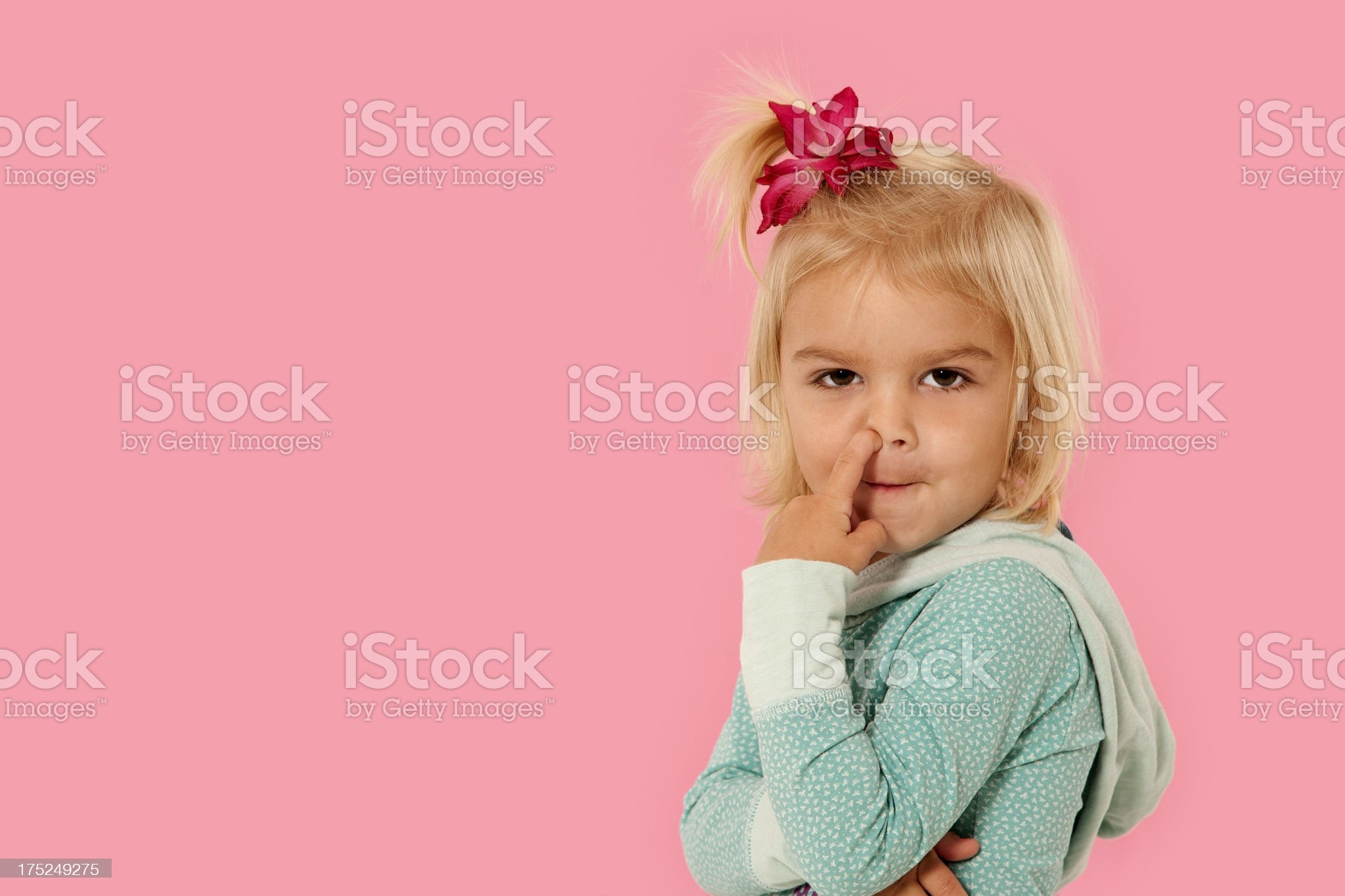 Little girl picking her nose royalty-free stock photo