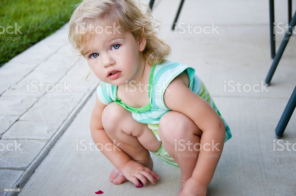 Little Girl Picking Up Flowers royalty-free stock photo