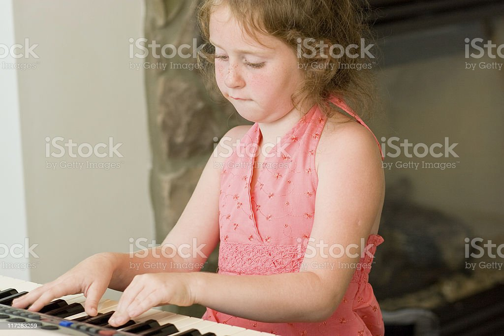 Little girl play piano stock photo