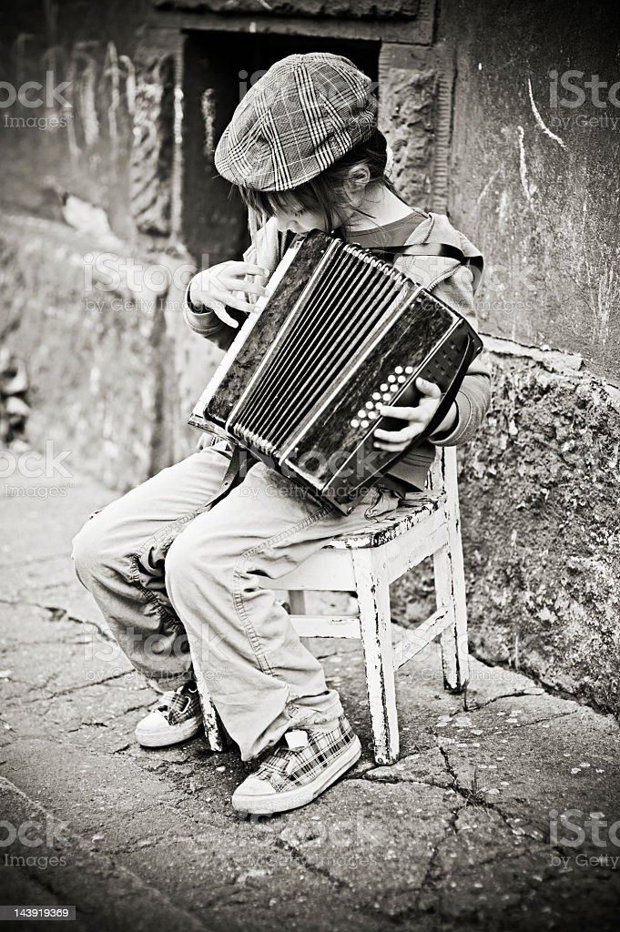 Little girl playing accordion royalty-free stock photo