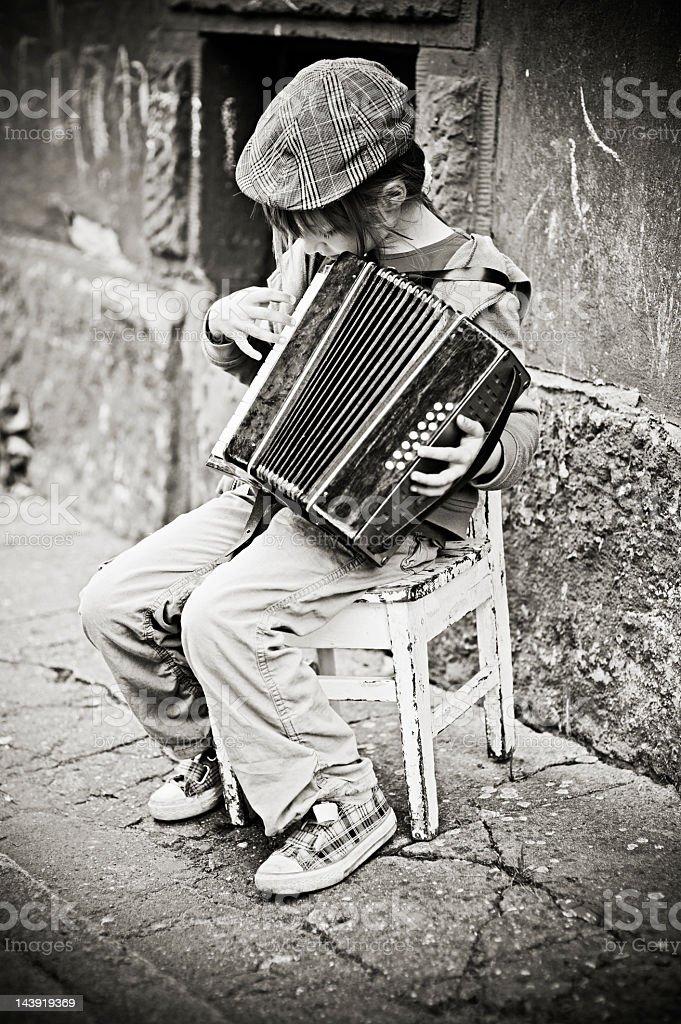 Little girl playing accordion stock photo