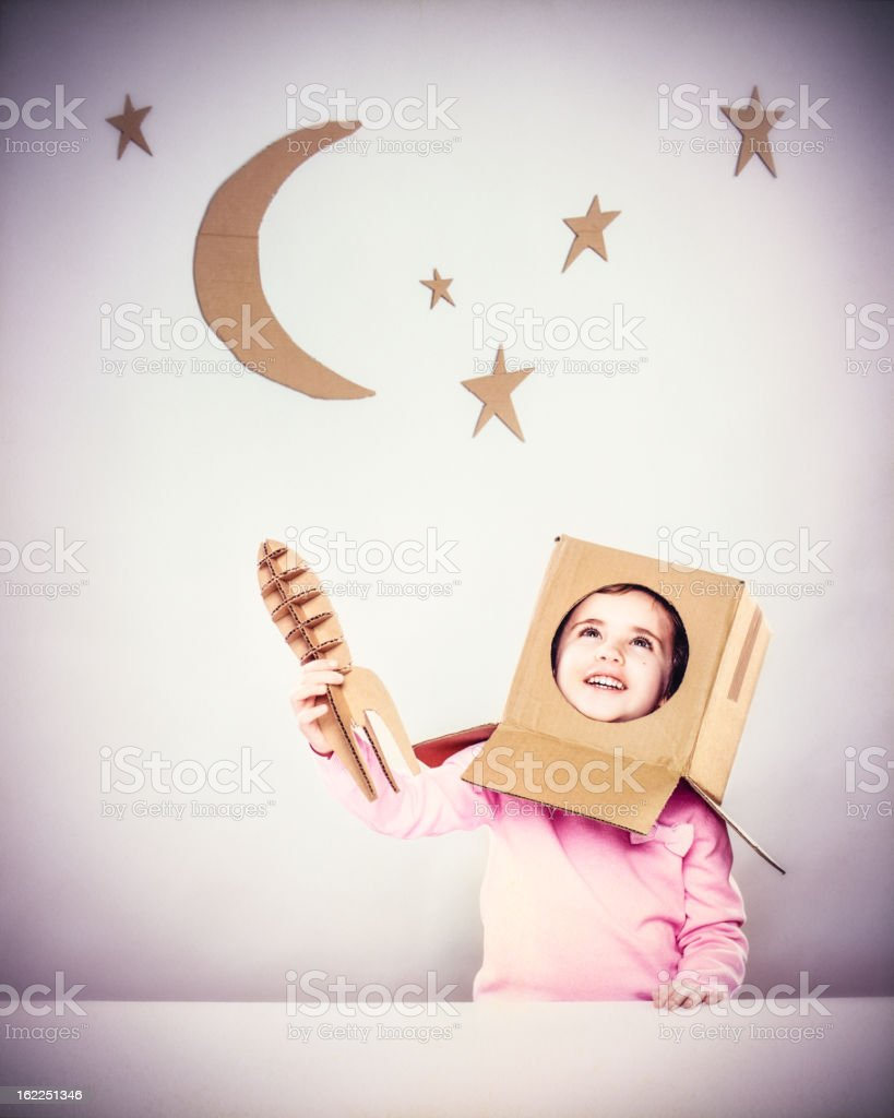 Little girl playing astronauts royalty-free stock photo