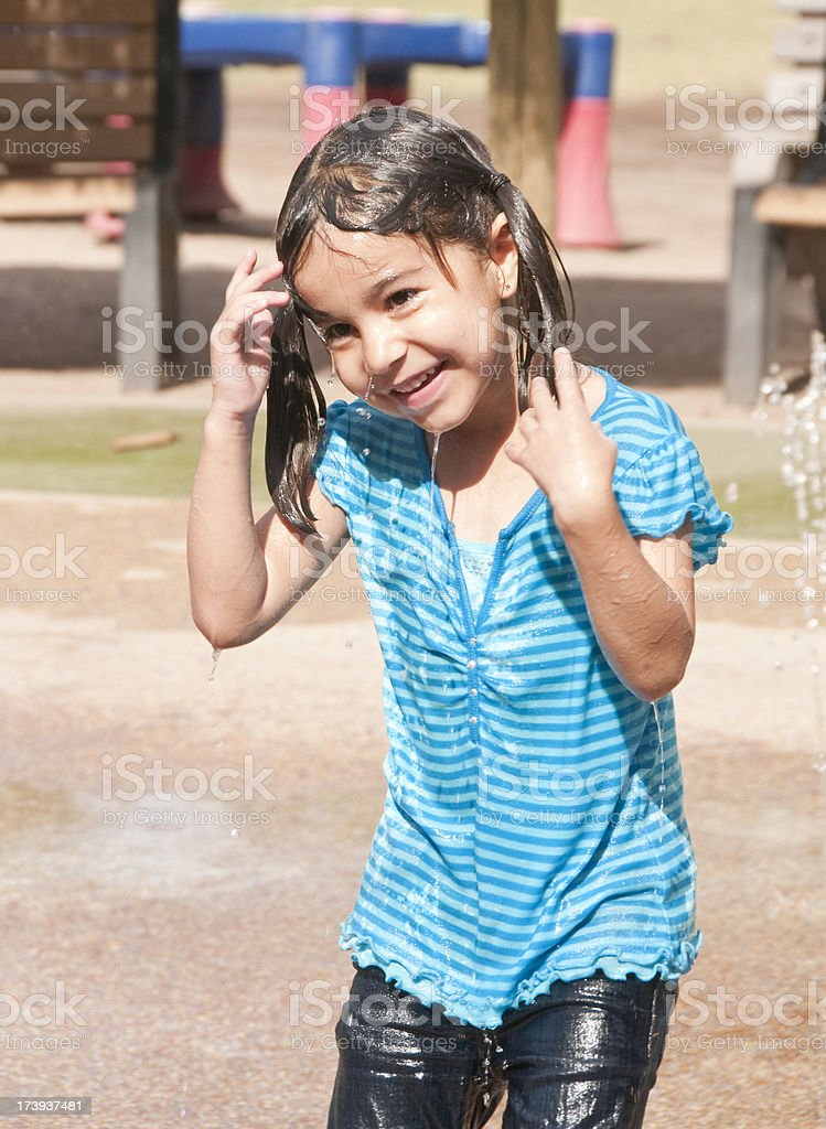 Little Girl playing at a water park royalty-free stock photo