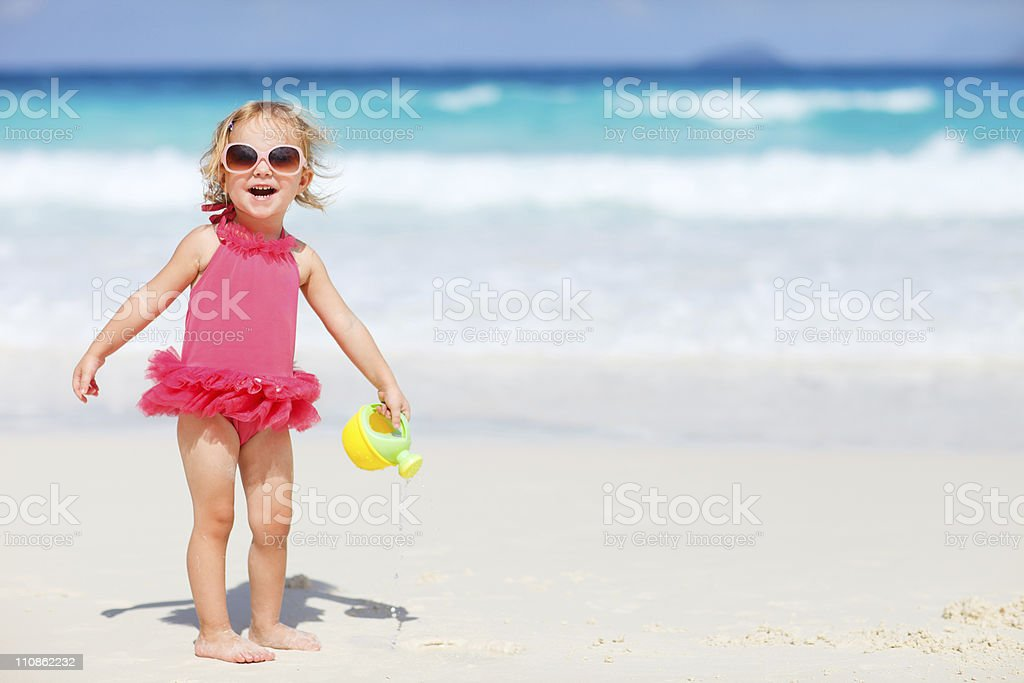 Little girl playing at beach royalty-free stock photo
