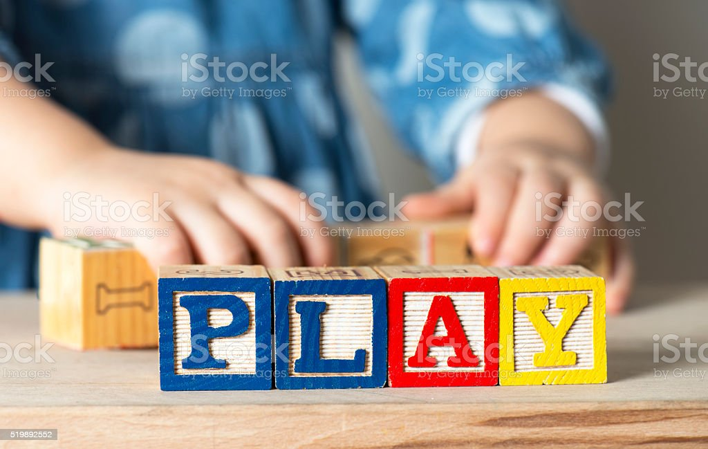 Little girl playing blocks stock photo