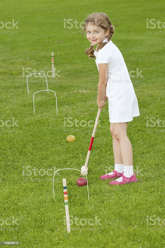 Little girl playing croquet stock photo
