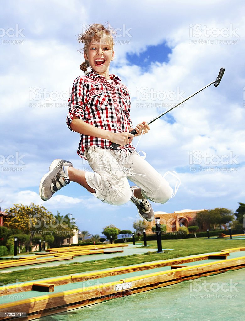 little girl playing golf in park. royalty-free stock photo
