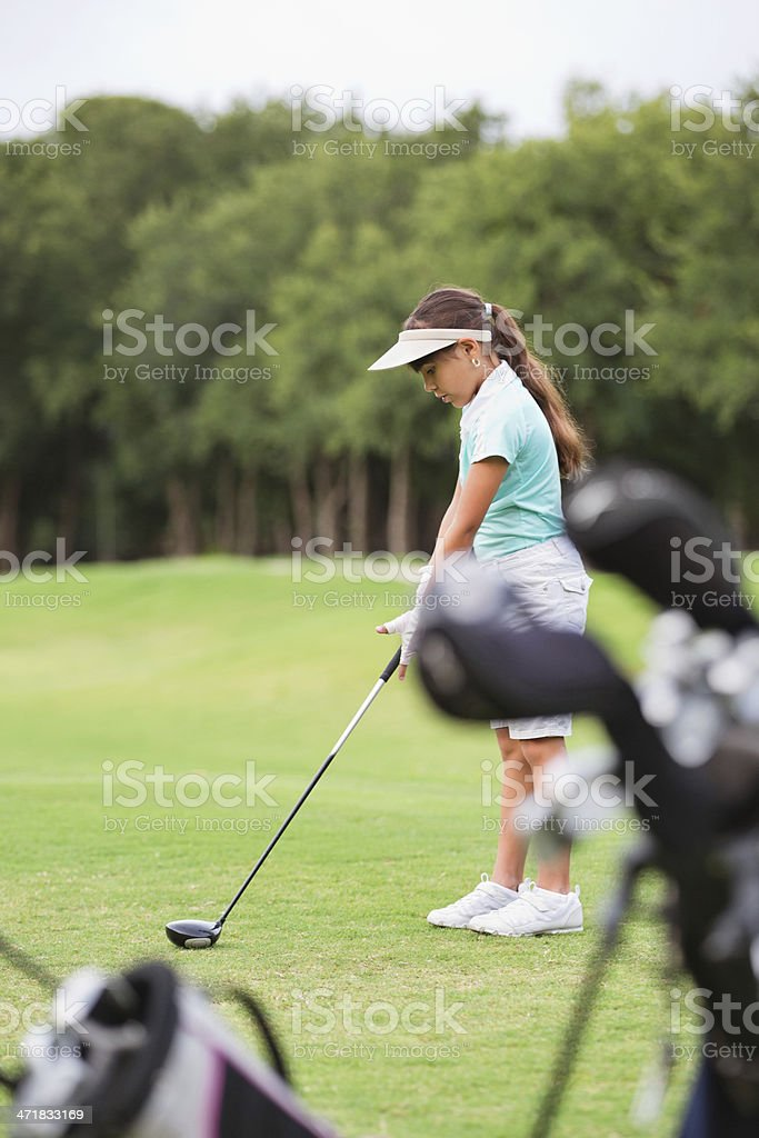 Little girl playing golf on green course royalty-free stock photo