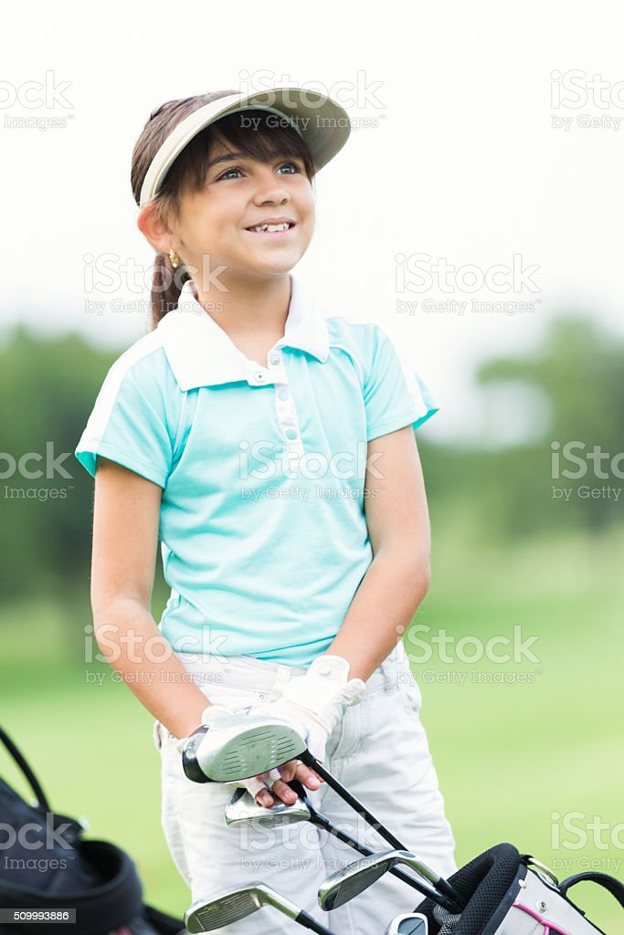 Little girl playing golf with family stock photo