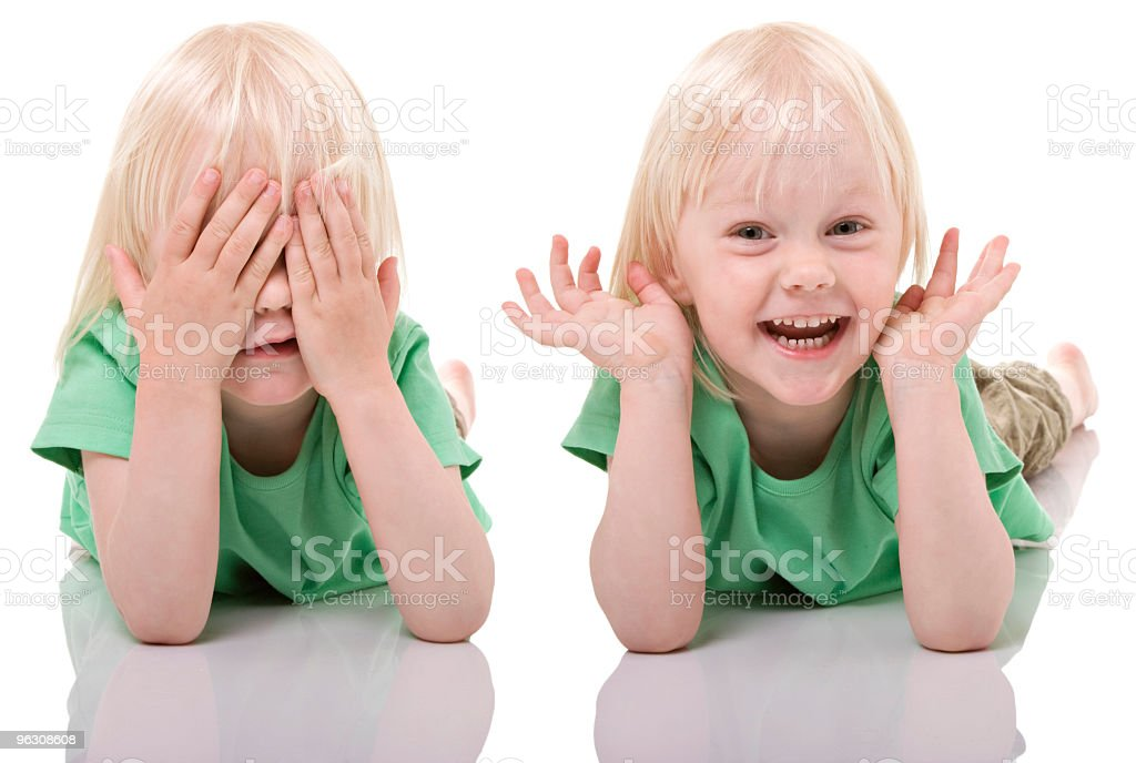 Little girl playing hide and seek royalty-free stock photo