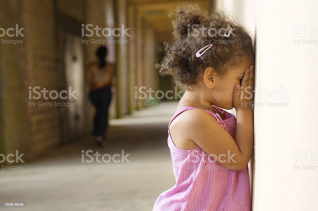 Little Girl (4-5) Playing Hide and Seek with her Mother stock photo