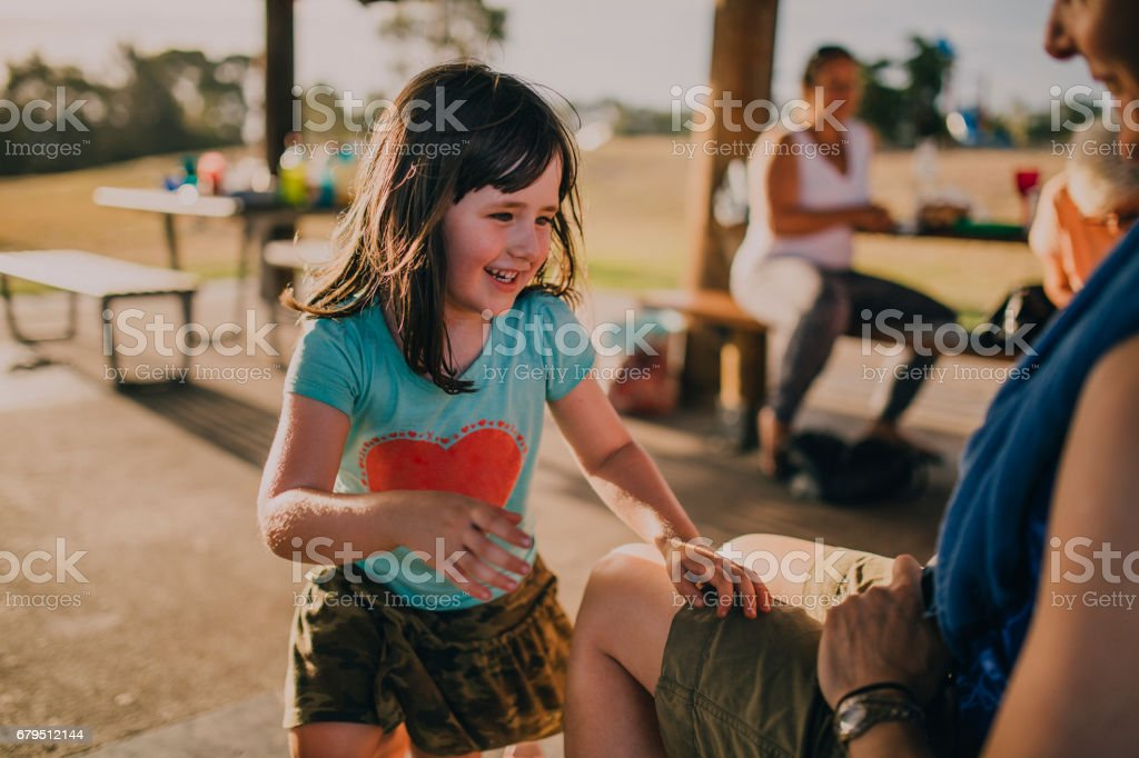 Little Girl Playing in a Park stock photo